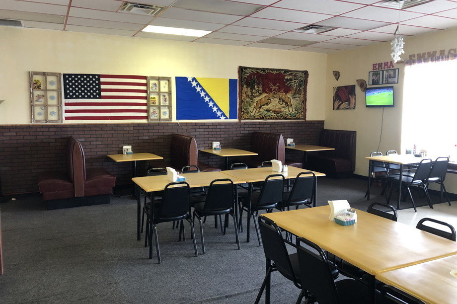 Interior of restaurant with flags of the United States and Bosnia and Herzegovina