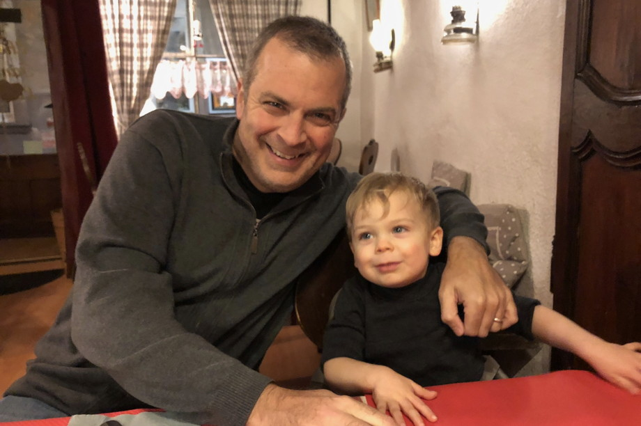 Father and young son in a restaurant, smiling for the camera
