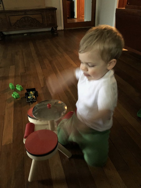 Toddler drumming so fast his arms are a blur
