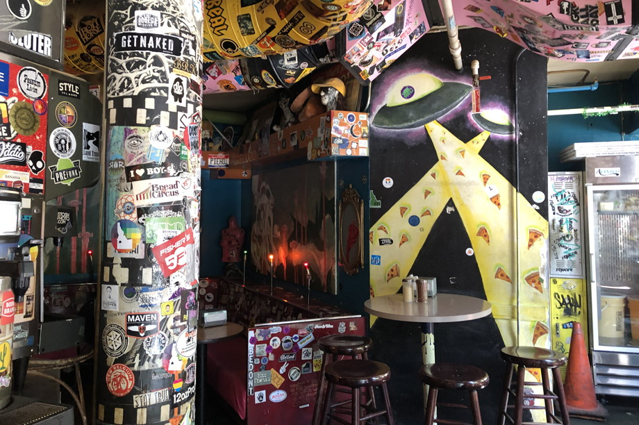 Restaurant interior in many colors, covered in stickers